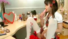 An exotic Asian harlot is gratifying her awesome wee vagina hole herself